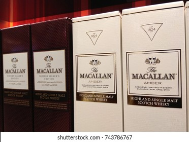 CHANGI AIRPORT, SINGAPORE - OCTOBER 4, 2017: Macallan Highland Single Malt Scotch Whiskey on Store Shelf. The Macallan Distillers Ltd, is a wholly owned subsidiary of the Edrington Group.