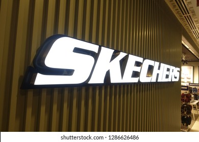 Changi, Singapore - January 14, 2019 : Close up of a Sketchers logo in front of an outlet at Changi Airport