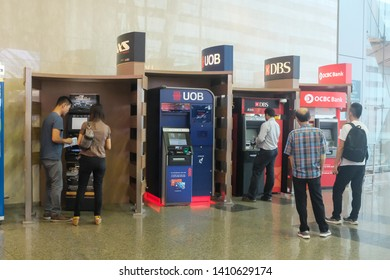 Changi, Singapore - May 5, 2019 : A row of assorted ATMs (automated teller machine) from Banks such as UOB, DBS and OCBC at Changi Airport