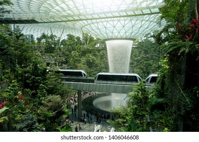 Changi, Singapore - May 6, 2019 : View of the HSBC Rain Vortex with trains passing at Jewel Changi