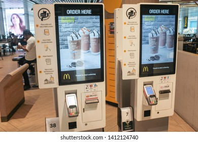 Changi, Singapore - May 6, 2019 : Self ordering electronic kiosks in a McDonalds fast food outlet at Changi Terminal 4