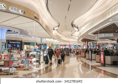Changi, Singapore - May 6, 2019 : Customers shopping at a duty free area selling a variety of famous cosmetics, perfumes and alcohol at Changi Terminal 4
