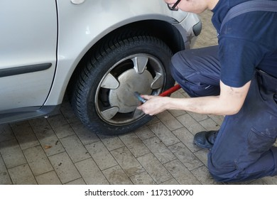 Changing car tyre in an auto repair shop