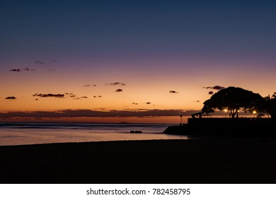 Changing color of the sky at sunset using long exposure at Ala Moana Beach Park, Oahu, Hawaii