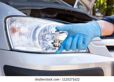 Changing halogen bulb in car headlight