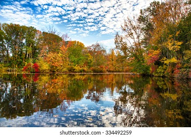 The changing leaves bring splashes of color to the historic Kirby's Mill pond in Medford, NJ.