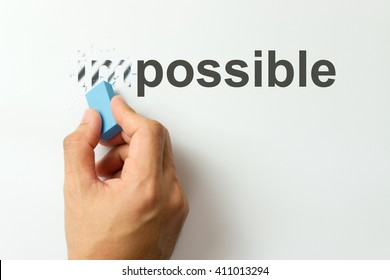 Changing the word impossible to possible with a eraser