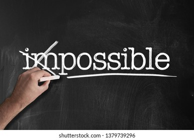 changing word impossible to possible on chalkboard motivation concept