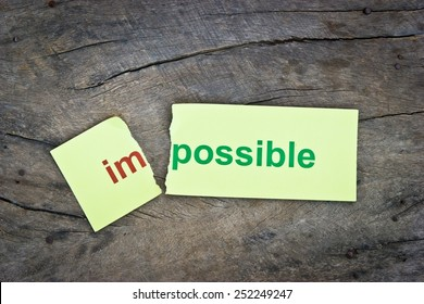 Changing word impossible transformed to possible. Conceptual of successfully overcoming problems.