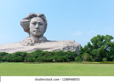 Changsha. China. 15 September 2018.Statue of young Mao Zedong in the orange Isle.