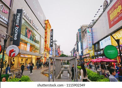 Changsha, China April 4, 2018: Huangxing Road Downtown Walking Street with Light Sign and Billboards Background.