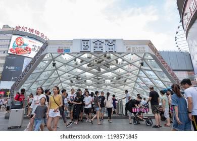CHANGSHA, CHINA - JULY 29, 2018: An entrance of subway station with many people at Huangxing road walking street in Changsha, China