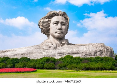 CHANGSHA, CHINA - OCT 29, 2017: Youth Mao Zedong Statue is located in Orange Isle, Changsha, Hunan, China. The monument stands 32 metres tall.