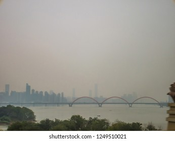Changsha cityscape view from the bus with crossing river Bridge in Foggy day.Changsha city China travel