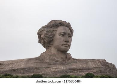 Changsha, Hunan, China  - JUNE 13, 2016 : Young Mao Zedong president statue at Orange Isle.