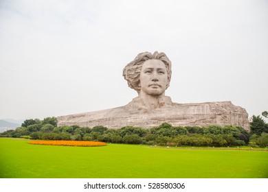CHANGSHA, HUNAN, CHINA - NOV 6, 2016 : Mao Zedong sculpture in orange Chau Tau, Changsha City, Hunan Province, china.