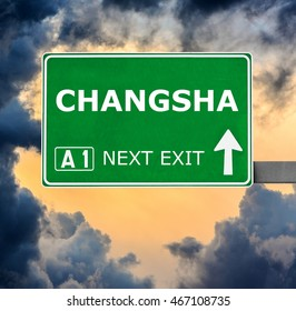 CHANGSHA road sign against clear blue sky