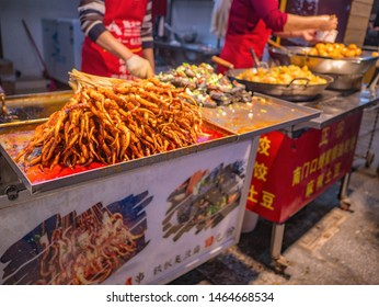 Changsha/China-17 October 2018:Roasted  Squid in Food alley at huangxing walking street in Changsha city China.changsha is the capital and most populous city of Hunan province in china