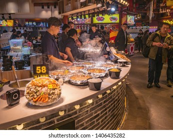 Changsha/China-17 October 2018:Unacquainted People in Street Food Alley at Changsha city China.changsha is the capital and most populous city of Hunan province in china