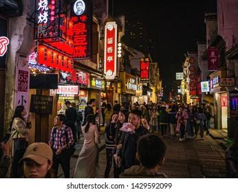 Changsha/China-17 October 2018:Unacquainted People or tourist walking on Taiping old Street in the evening time at Changsha city hunan China.Taiping old street one of landmark in changsha city
