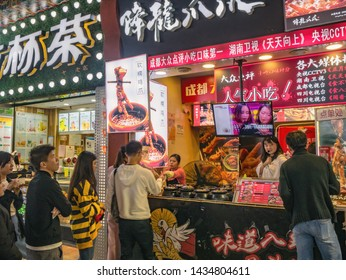 Changsha/China-17 October 2018:Unacquainted People walking in Food alley at huangxing walking street in Changsha city China.changsha is the capital and most populous city of Hunan province in china