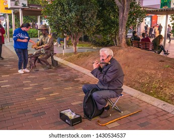 Changsha/China-17 October 2018:Unacquainted Senior street performers singing at huangxing walking street in Changsha city China.changsha is the capital and most populous city of Hunan province china