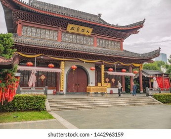 Changsha/China-18 October 2018:Unacquainted people and chinese building on Orange Island Park Changsha city hunan China.changsha is the capital and most populous city of Hunan