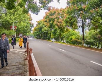 Changsha/China-18 October 2018:Unacquainted people walking on Orange Island Park Changsha city hunan China.changsha is the capital and most populous city of Hunan