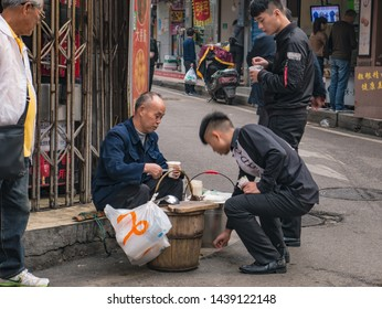 Changsha/China-18 October 2018:Unacquainted Senior People Selling tofu on Street in the morning at Changsha city hunan China.Taiping old street one of landmark in changsha city