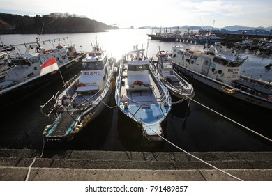 CHANGWON, KOREA - JANUARY 10, 2018: Parked many ships at dock with sunset.