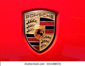 Chanhassen, MN/ USA- June 3rd, 2017. Closeup of a red Porsche automobile that focuses on the logo. Porsche is a German Automobile manufacturer that creates high-performance sports cars, SUVs & sedans.