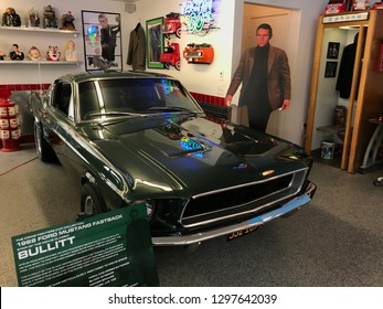 Chanhassen, MN/USA. June 3rd, 2017. The interior of a garage featuring a 1968 Ford Mustang Fastback, the car of Steve McQueen in the film Bullitt. A cutout of McQueen is also on display.