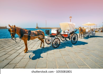 Chania, Crete - 23 Maj, 2016: Horse carriage for transporting tourists in old port of Chania on Crete, Greece. Chania is the second largest city of Crete and a very popular city visited by tourists