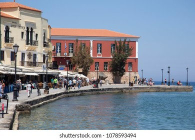 Chania, Crete/ Greece - 27th April 2018: View of the port of Chania city and the colorful buildings at the port side.