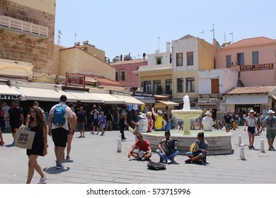 CHANIA, CRETE ISLAND, GREECE - JULY 30, 2016: Three young boys play accordion, tomtom and lute to earn money from the bypassers at Kanevarou street.