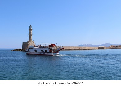 """CHANIA, CRETE ISLAND, GREECE - JULY 26, 2016: """"Evagelos II"""" catamaran leaves old Venetian Harbor and heads to Theodorou and Lazareta, carries tourists for a swimming and snorkeling trip."""