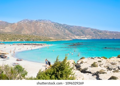 Chania, Crete - September, 18, 2017 People enjoy a beutiful day in Elafonisi Beach, the amazing pink beach of Crete