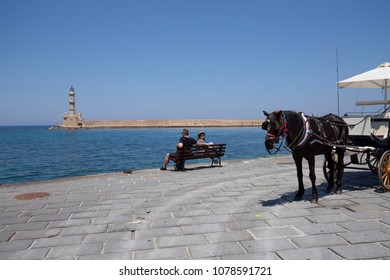 Chania, Crete/Greece - April 27th 2018: View of the Chania Lighthouse and the horse waiting.