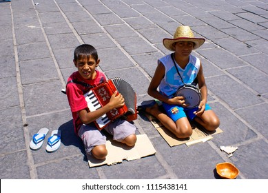 Chania, Greece, 22 July 2009.Two gypsy boys play music