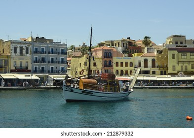 CHANIA, GREECE - MAY 27: Unidentified people, excursion boat and different restaurants and hotels on the harbor of the medieval village in Crete, on May 27, 2014, in Chania, Greece
