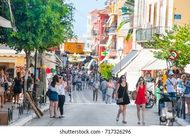 CHANIA,CRETE-AUGUST 08: Narrow street with local restaurants and traditional shops, tourists go shopping on August 08,2017 in Chania city on Crete island, Greece.