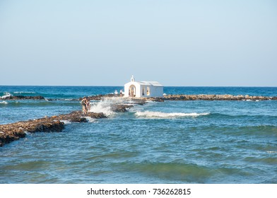 Chania,Grete-August 08: Cretan landscape during the midday with Orthodox chapel in the distance on August 08,2017 on Crete island. Greece.