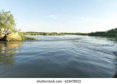 Channel landscape with waves in Danube Delta, Romania, on summer day