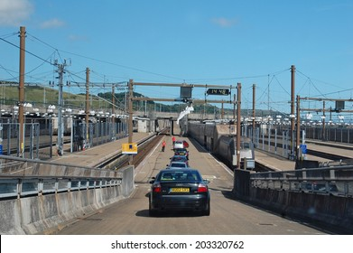 CHANNEL TUNNEL, ENGLAND - August 3: cars about to board the train for the Channel Tunnel crossing from England on August 3, 2013. High speed eurostar trains carry vehicles between England and France.