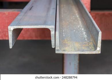 Channel (u shape beam) steel in factory shelf, focusing on the cutting edge
