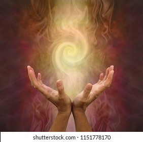 Channeling Golden Vortex healing energy  - female hands held open and palms upwards with a vortex energy formation above on a warm golden brown background