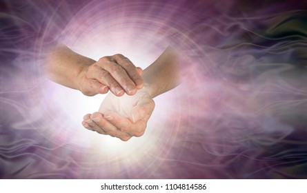 Channeling vortex spiral between hands - female cupped hands with white vortex energy between on a wide pink purple spiralling light burst background with copy space