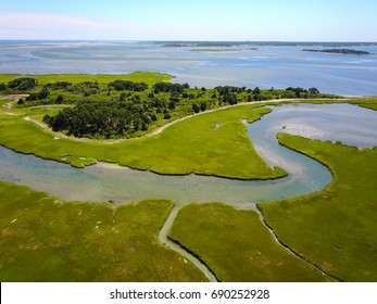 Channels wind through a marsh in Pleasant Bay, Cape Cod, Massachusetts. Marshes and wetlands provide flood and erosion control and furnish food and homes for fish, birds and other wildlife.