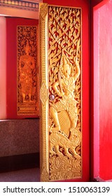 CHANSEN -NAKHONSAWAN/ THAILAND-JULY 16, 2019: Wooden carving of god guard holding sword in right hand and step on lion, and the god guard on the window at background.