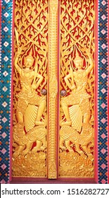 CHANSEN -NAKHONSAWAN/ THAILAND-JULY 16, 2019: Wooden carving arts on the door of two god guards holding swords in both hands and standing on the lion over the cloud, Wat Chansen.